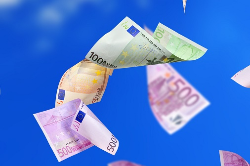 falling many euro banknotes on a sky background